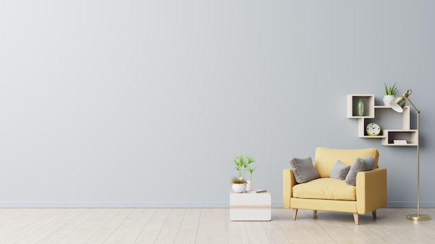 The interior has a yellow armchair on empty gray wall background.