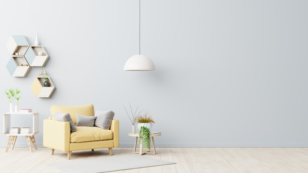 The interior has a yellow armchair on empty gray wall