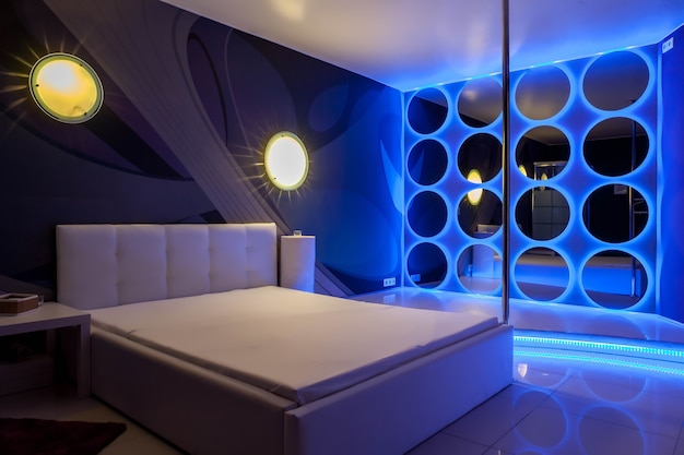 Interior of hotel room in residence is furnished modernly, where men hire prostitutes for male pleasures. escort, prostitution, private dancing, striptease show concept. copy space background