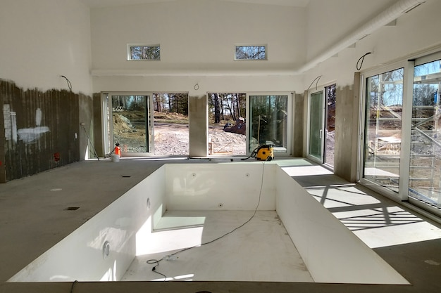 Interior of a house with big swimming pool under renovation works.