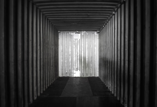 Interior of inside an empty shipping cargo container. warehouse logistics and freight transportation.