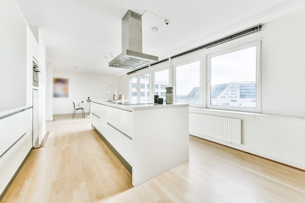Interior of light kitchen with modern cupboards and appliances
