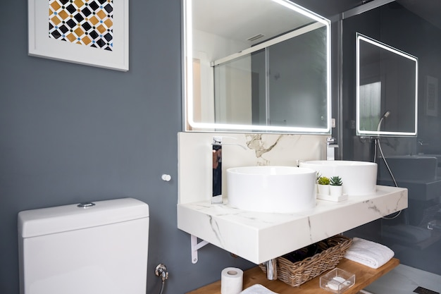 Interior of light modern bathroom with a mirror with light