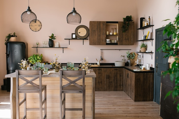 The interior of the living room of a country house made of wood in the scandinavian style. bar table with chairs and kitchen