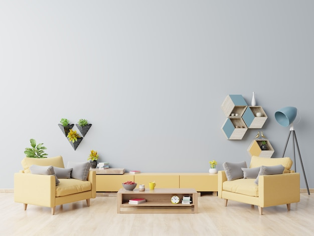 Interior of living room with yellow armchair, wooden coffee table on wooden flooring and blue wall.