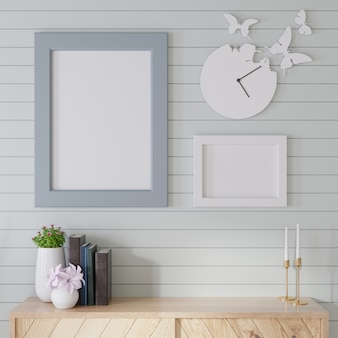 Interior mockup a wooden cabinet with blue slats on the wall and photo frames is put in a room