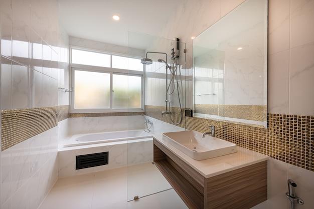 Interior of modern bathtub bathroom and sink interior in a hotel