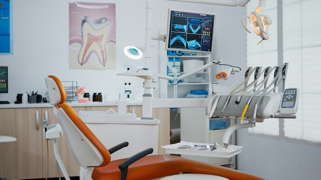 Interior of modern dental office in hospital with dentistry orthodontic furniture