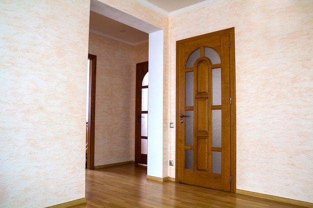 Interior of modern expensive house of apartment with wooden doors