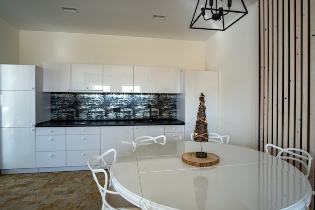 Interior of modern kitchen with contemporary furniture.