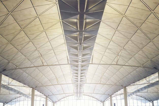 Interior of the modern mall of hongkong airport subway station, ceiling of modern building