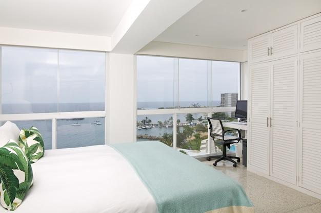 Interior of modern room, overlooking the sea.