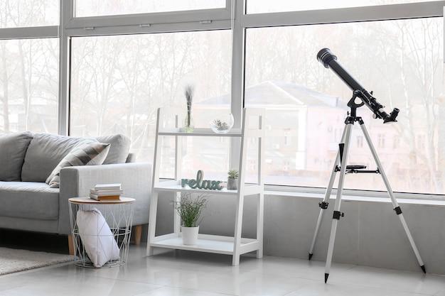 Interior of modern room with telescope