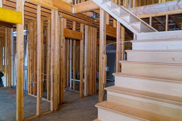 Interior of a new home wooden beams at construction residential house framing