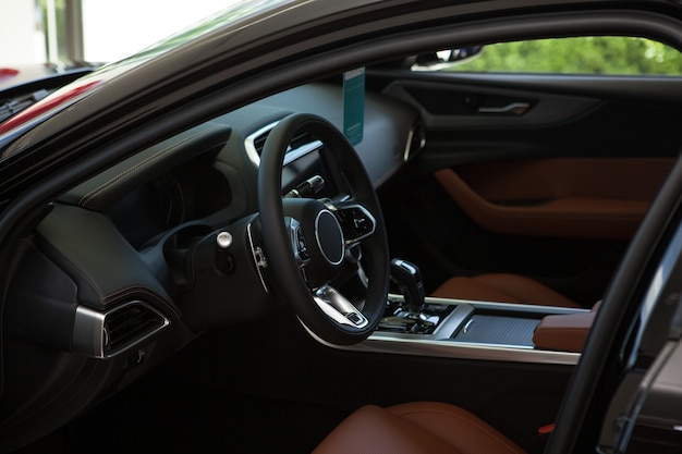 Interior of a new luxury car at the dealership salon, copy space