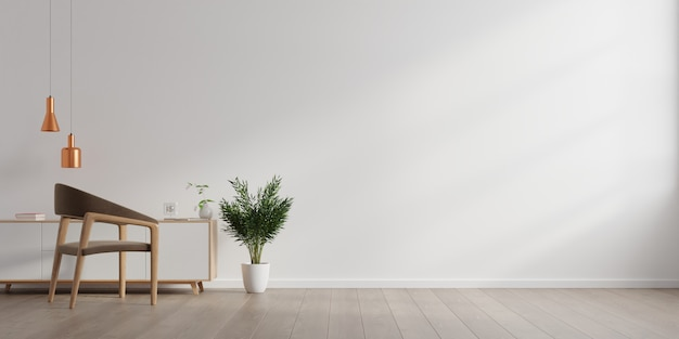 空の白い壁の背景にアームチェアのある明るいリビングルームのインテリア。 Premium写真