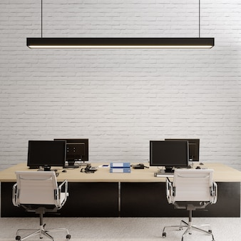 흰색 벽돌 벽 앞에 책상이있는 사무실 인테리어