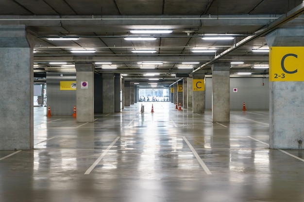Interior of parking garage with vacant parking lot in parking building