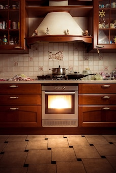 Interior photo of country style kitchen with hot oven