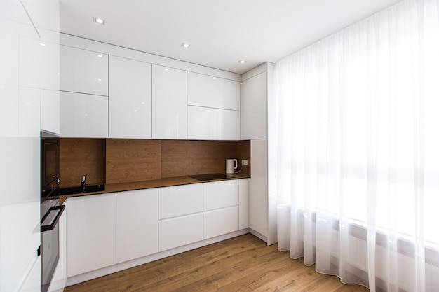 Interior photo of modern kitchen in white