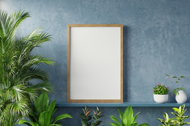 Interior poster mockup with plant in room with dark blue wall.