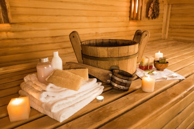 Interior of sauna and sauna accessories on background