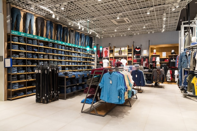 Interior shot of racks with shirts, undershirts and jeans