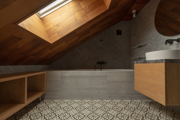 Interior of stylish attic bathroom