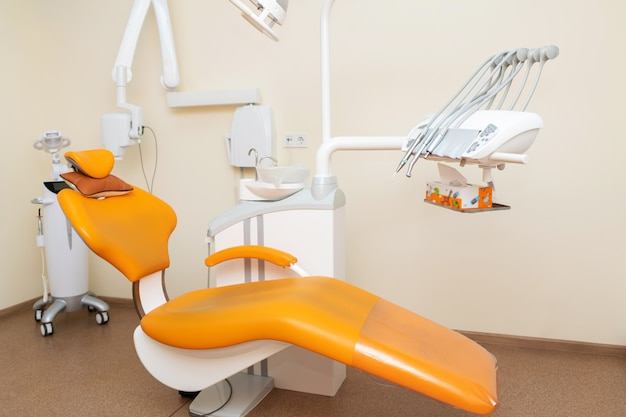 Interior stylish modern dentist office in orange style.