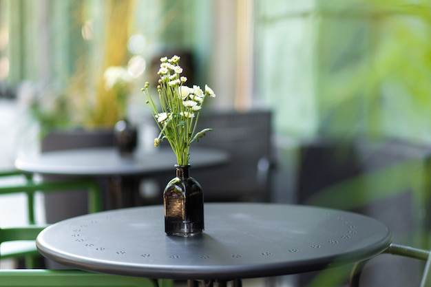 Interior of a summer playground without people with fresh flowers in pots. a cozy cafe.