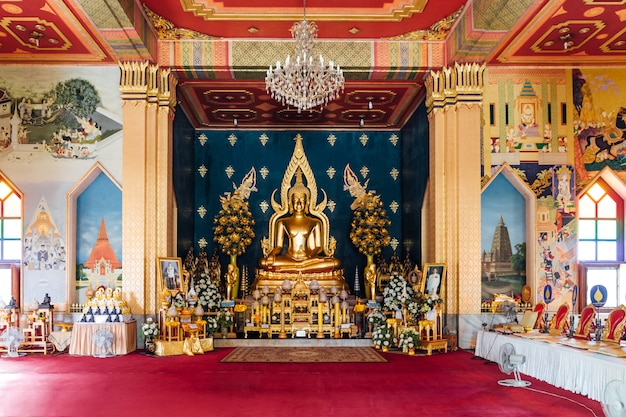 Interior of thai monastery (thai temple) decorated with thai art and golde lord buddha statue in the center at bodh gaya, bihar, india.