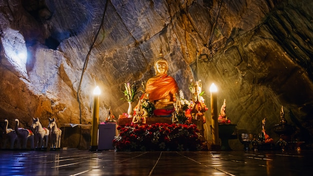 Interior of tham pha jom golden temple in the cave in chiang rai, thailand