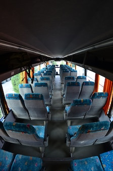 Interior of the tourist bus for excursions and long trips. a lot of free seats and places for small luggage