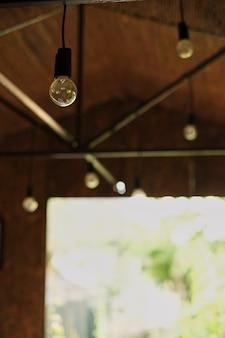 Interior of vintage light bulb hall hang in wooden room. barn decor