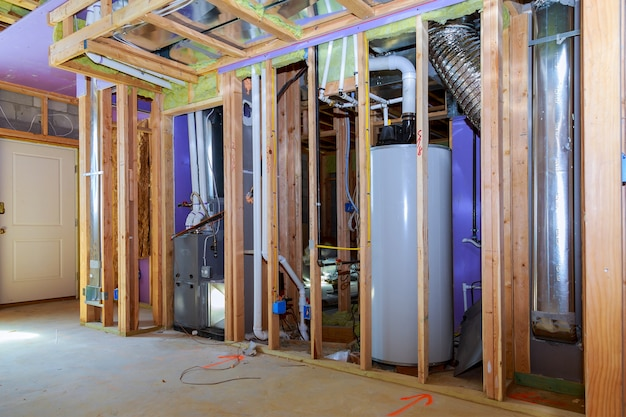 Interior wall framing with piping and wiring installed