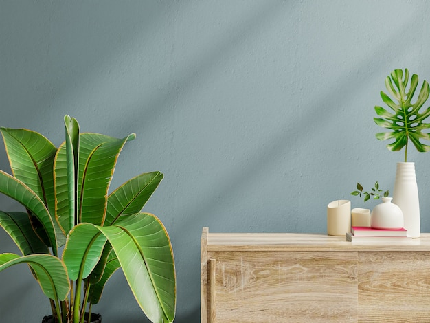 Interior wall mockup with green plant,dark blue wall and shelf.3d rendering