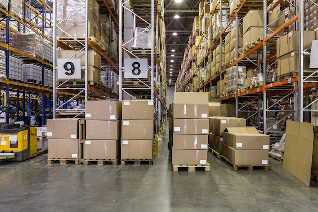 Interior of warehouse with racks full of boxes and goods