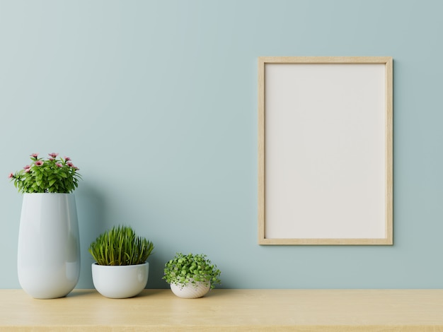 Interior with plants,  frame on empty blue wall b