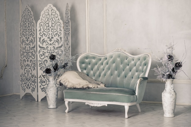 Interior with vintage furniture, light spring studio with beautiful white sofa. white interior of studio.