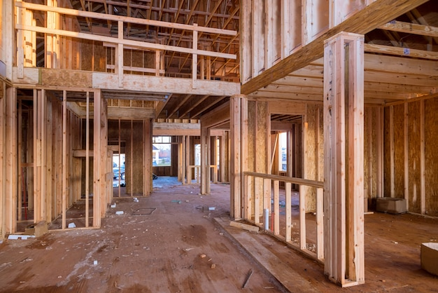 Interior with wood framing beam of new house under construction beam wood