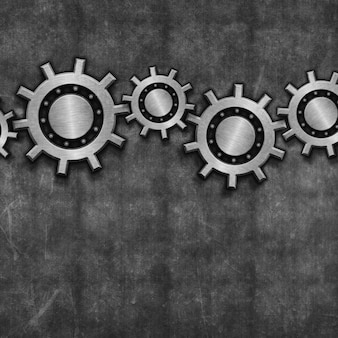 Interlocking gears on grunge background