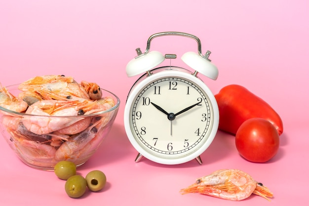 Intermittent fasting concept - countdown to eat shrimp and vegetables