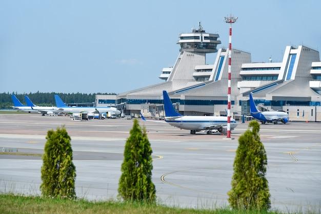 International airport, passenger boarding, passenger aircraft.