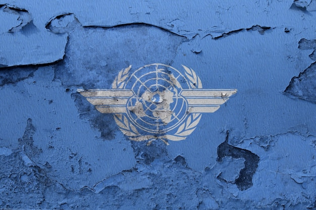 International civil aviation organization flag painted on grunge cracked wall