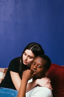 International couple man woman interracial thoughtful problem serious relationship family issue hug support concept