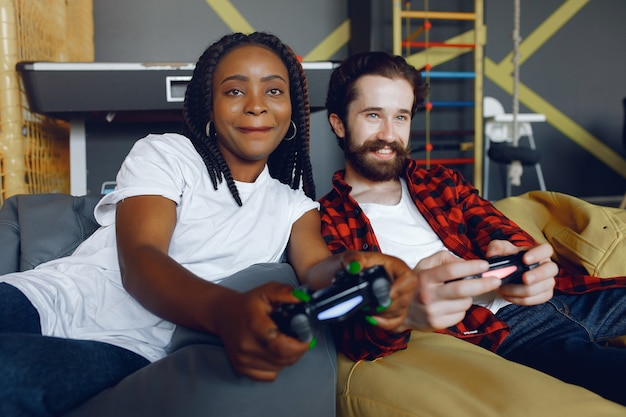 International couple playing a video games Free Photo