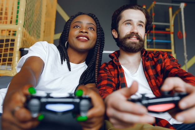 International couple playing a video games