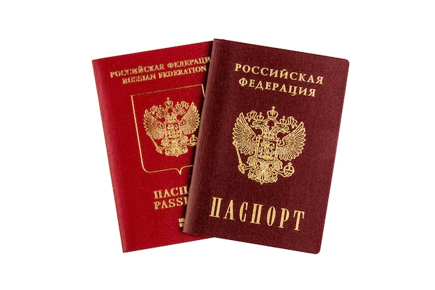 International and domestic russian passports isolated on a white wall top view close up