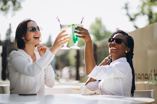 International girls friends in a bar