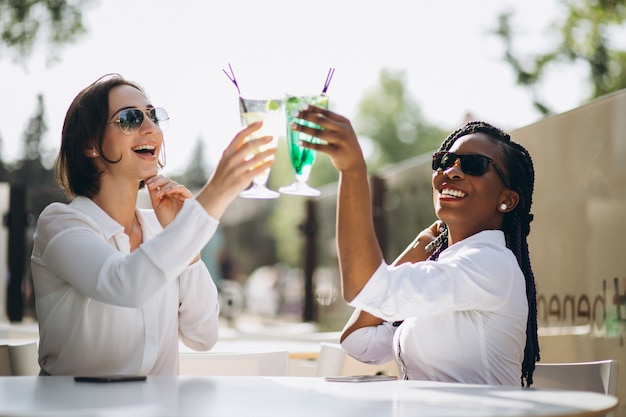 International girls friends in a bar Free Photo